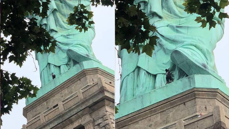 Una mujer escala la Estatua de la Libertad como protesta a las políticas migratorias de Trump