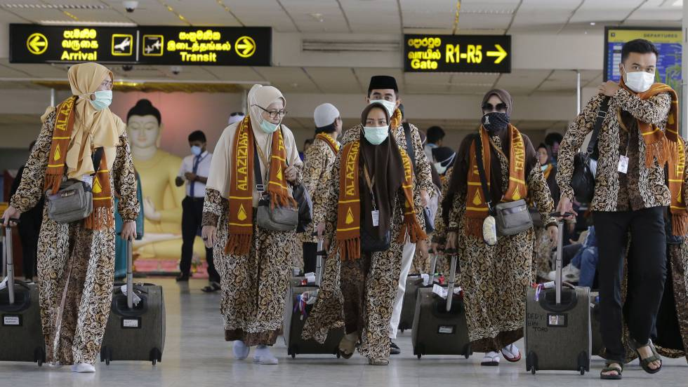 pasajeros con mascarillas